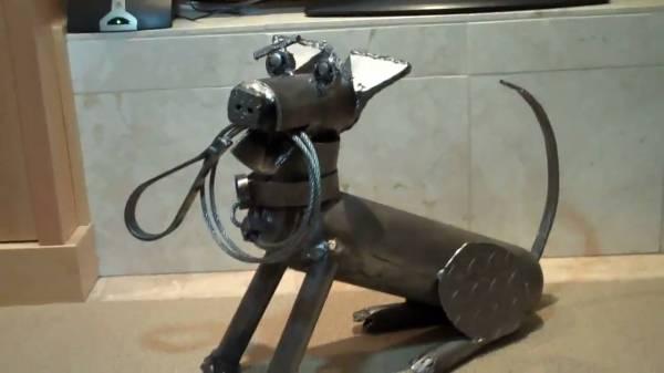 a small scrap metal dog sculpture